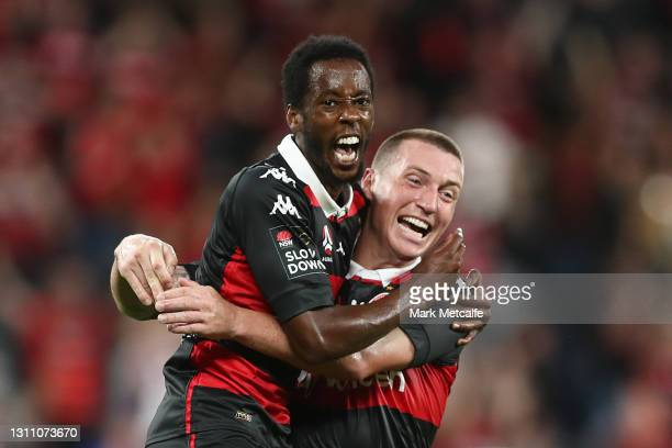 Bruce Kamau of the Wanderers celebrates with Mitch Duke of the Wanderers after scoring his second goal during the A-League match between Western...
