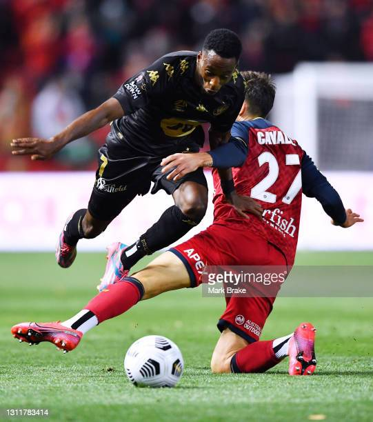Bruce Kamau of the Wanderers is fouled by Joshua Cavallo of Adelaide United during the A-League match between Adelaide United and the Western Sydney...