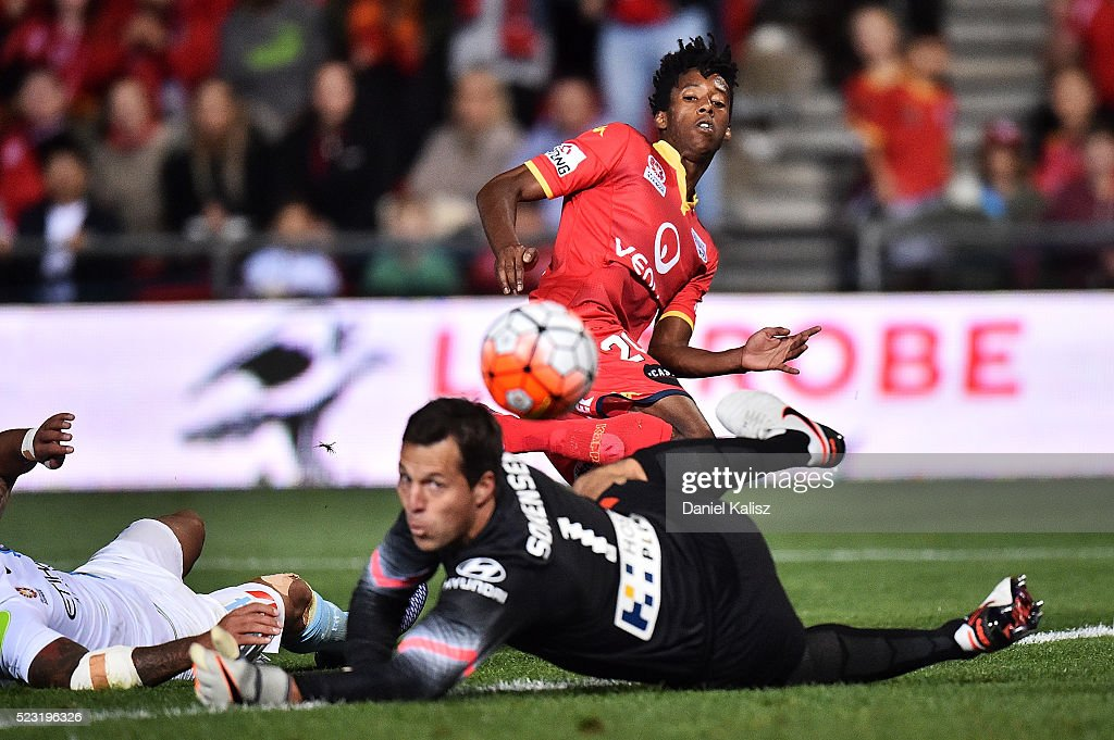 Bruce Kamau of United strikes the ball as Thomas Sorensen of Melbourne City attempts a save during the A-League Semi Final match between Adelaide United and Melbourne City at Coopers Stadium on April 22, 2016 in Adelaide, Australia.