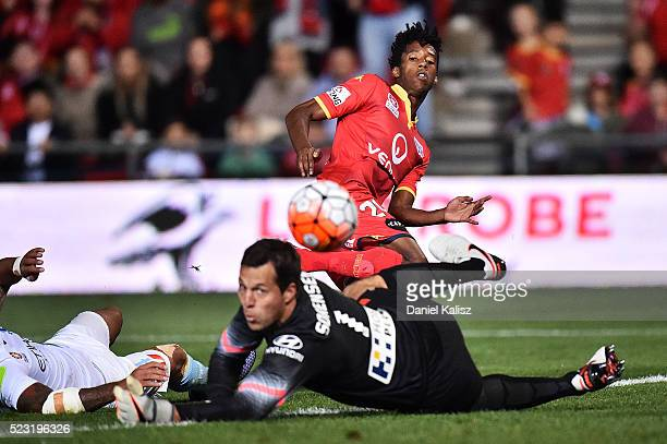 Bruce Kamau of United strikes the ball as Thomas Sorensen of Melbourne City attempts a save during the ALeague Semi Final match between Adelaide...
