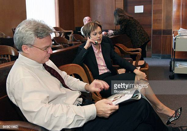 Bruce Kiernan attorney for Merck maker of the drug Vioxx reads the paper with fellow attorney Amanda Bailey to the right with the jury room door in...