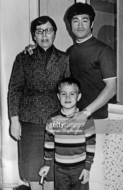 Bruce Lee along with his mother and son Brandon pose for a family snapshot circa 1970 in Los Angeles California