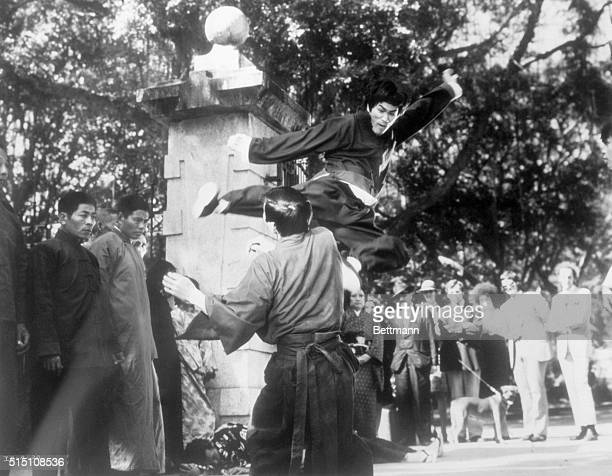 Bruce Lee demonstrates a Kungfu kick for the benefit of visitors to the set of The Chinese Connection Undated photo