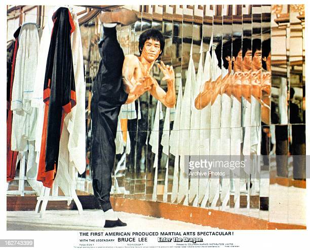 Bruce Lee high kicks in a scene from the film 'Enter The Dragon' 1973