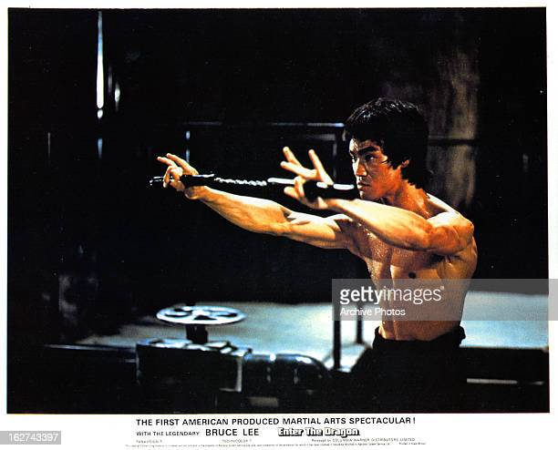 Bruce Lee trains in a scene from the film 'Enter The Dragon' 1973