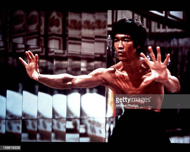 Bruce Lee with fresh scratch marks on his face and chest in a scene from the film 'Enter The Dragon' 1973