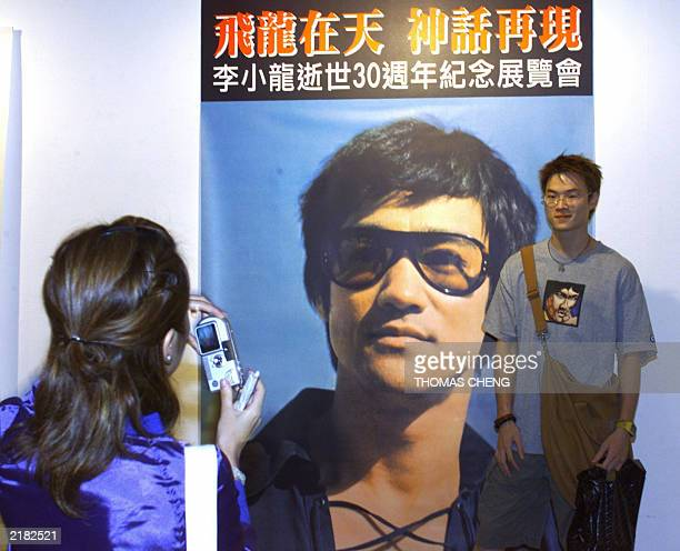 A Bruce Lee's fan poses for a picture at the exhibition of Lee's 30 anniversary of his death in Hong Kong 18 July 2003 Lee lost consciousness at...