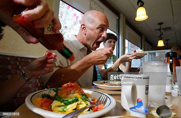 Bruce Lisker takes his first bite of freedom in the form of scrambled eggs and hash browns at an IHOP restaurant minutes after he is released from...