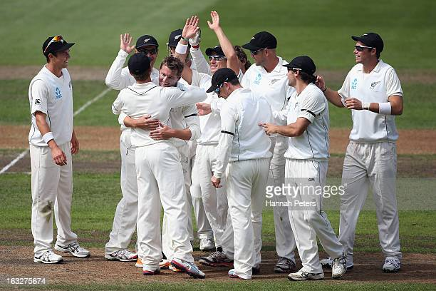 Bruce Martin celebrates his first test wicket of Matt Prior of England during day two of the First Test match between New Zealand and England at...