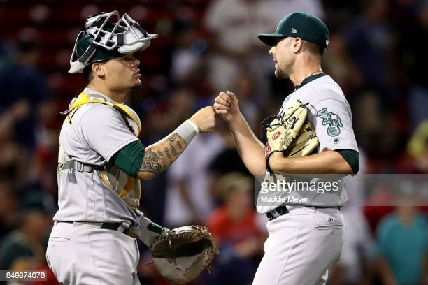 Bruce Maxwell of the Oakland Athletics and Blake Treinen celebrate after defeating the Boston Red Sox 73 at Fenway Park on September 13 2017 in...