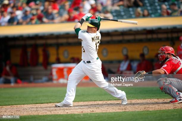 Bruce Maxwell of the Oakland Athletics bats during the game against the Los Angeles Angels of Anaheim at the Oakland Alameda Coliseum on September 4...