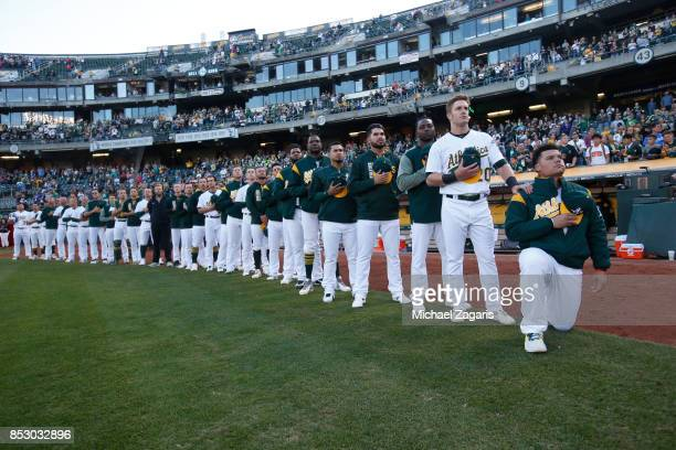 Bruce Maxwell of the Oakland Athletics kneels during the national anthem prior to the game against the Texas Rangers at the Oakland Alameda Coliseum...