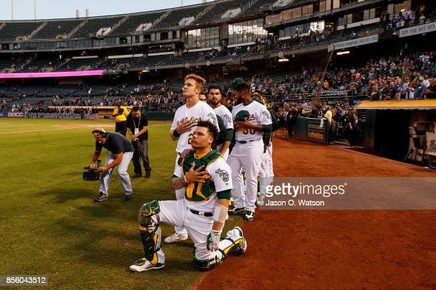 Bruce Maxwell of the Oakland Athletics kneels during the national anthem before the game against the Seattle Mariners at the Oakland Coliseum on...
