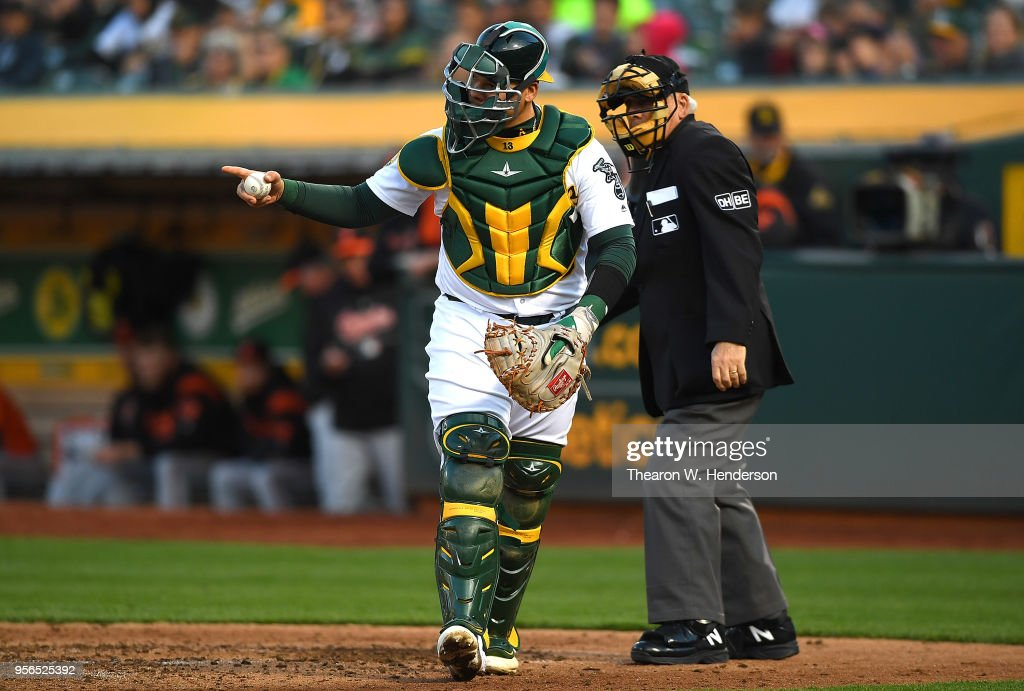 Bruce Maxwell #13 of the Oakland Athletics reacts after Trey Mancini #16 of the Baltimore Orioles strikes out to end the top of the fifth inning at the Oakland Alameda Coliseum on May 5, 2018 in Oakland, California.