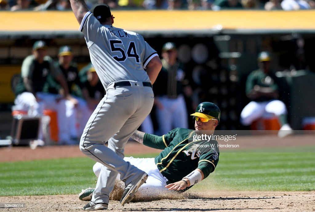 Bruce Maxwell #13 of the Oakland Athletics scores on a wild pitch from Chris Beck #54 of the Chicago White Sox in the bottom of the eighth inning at Oakland Alameda Coliseum on July 5, 2017 in Oakland, California.
