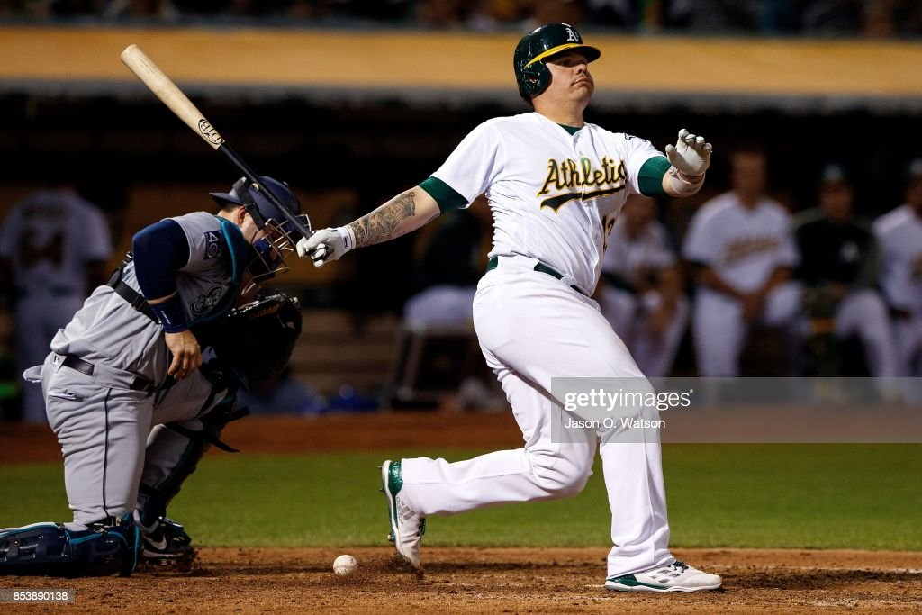 Bruce Maxwell #13 of the Oakland Athletics strikes out against the Seattle Mariners during the eighth inning at the Oakland Coliseum on September 25, 2017 in Oakland, California. The Seattle Mariners defeated the Oakland Athletics 7-1.