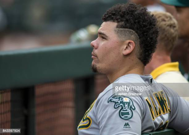 Bruce Maxwell of the Oakland Athletics watches play from the dugout during a game against the Seattle Mariners at Safeco Field on September 3 2017 in...