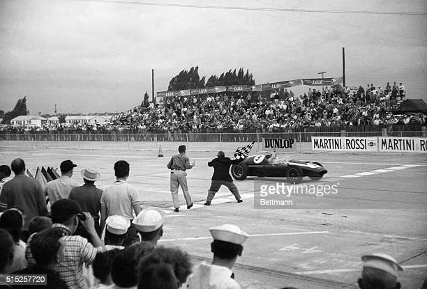 Bruce McLaren getting the checkered flag to win the first ever US Grand Prix in Sebring, Florida.