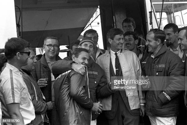 Bruce McLaren Ken Miles Leo Beebe Denny Hulme Chris Amon 24 Hours of Le Mans Le Mans 19 June 1966 Celebrating victory for the winning Ford drivers...