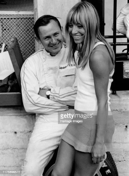 Bruce McLaren with female admirer in the pits 1967 Italian Grand Prix
