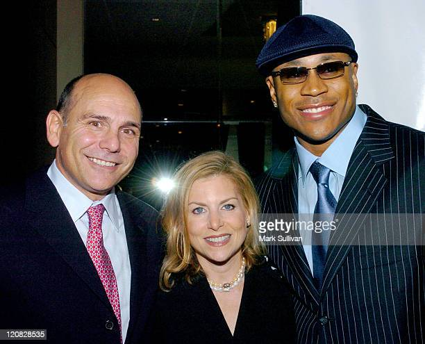 Bruce Newberg Dawn Ostroff and LL Cool J during A Place Called Home Gala For The Children Arrivals at The Beverly Hilton Hotel in Beverly Hills...