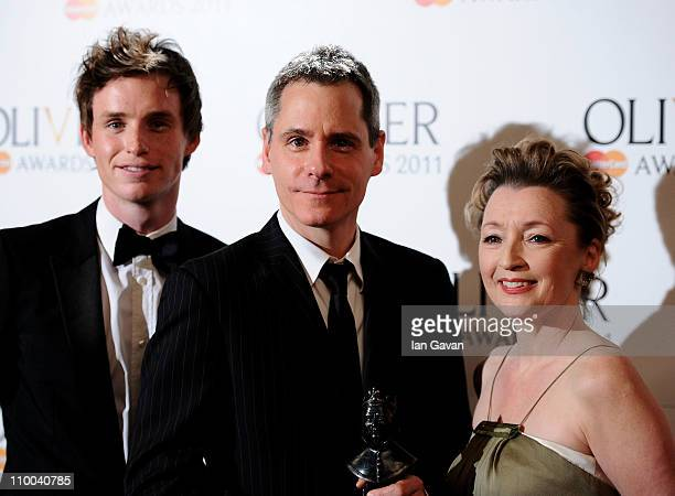 Bruce Norris winner of Best New Play for Clybourne Park poses with Eddie Redmayne and Lesley Manville in the press room during The Olivier Awards...