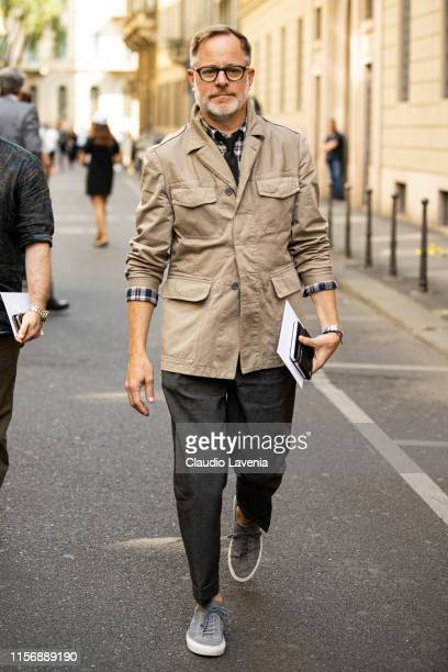 Bruce Pask wearing a checked shirt black necktie dark grey pants beige jacket and grey sneakers is seen outside Giorgio Armani show during the Milan...