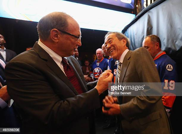Bruce Ratner and Charles Wang speak prior to the opening faceoff between the New York Islanders and the Chicago Blackhawks at the Barclays Center on...