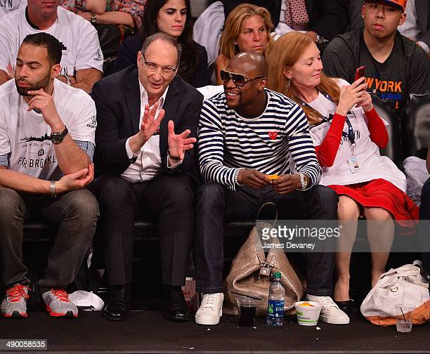 Bruce Ratner and Floyd Mayweather Jr attends the Miami Heat vs Brooklyn Nets game at Barclays Center on May 12 2014 in the Brooklyn borough of New...