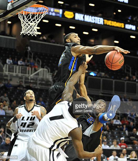 Bruce Reed of the Morehead State Eagles blocks Jamal Olasewere of LIU Brooklyn Blackbirds in the second half during the Barclays Center Classic at...