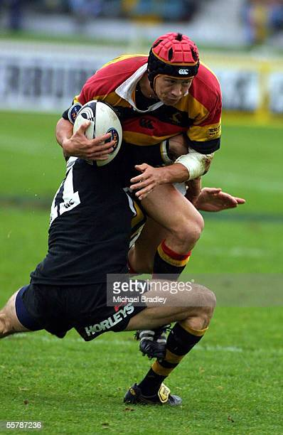 Bruce Reihana from Waikato is tackled by Dominic Byrne from Taranaki during their rugby NPC match played in Hamilton at Wetspactrust park Saturday...