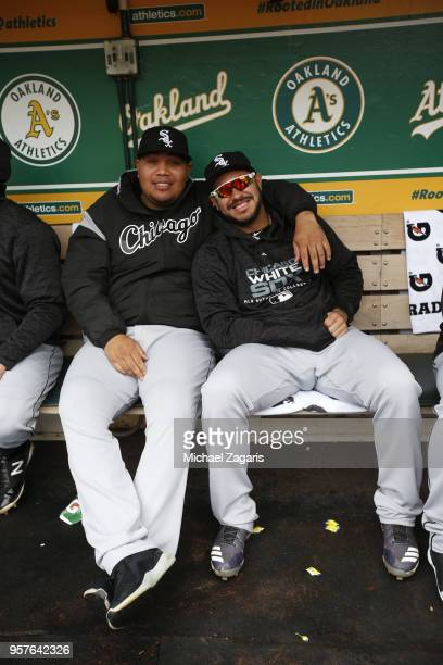 Bruce Rondon and Omar Narvaez of the Chicago White Sox relax in the dugout prior to the game against the Oakland Athletics at the Oakland Alameda...
