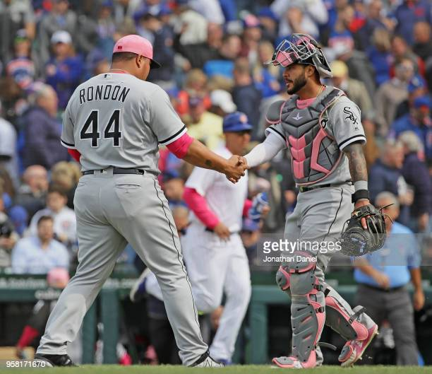Bruce Rondon of the Chicago White Sox shakes hands with Omar Narvaez after a win against the Chicago Cubs at Wrigley Field on May 13 2018 in Chicago...