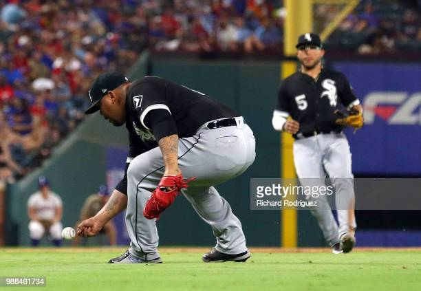 Bruce Rondon of the Chicago White Sox tries to field a ball bare handed hit by Robinson Chirinos of the Texas Rangers for an infield single in the...