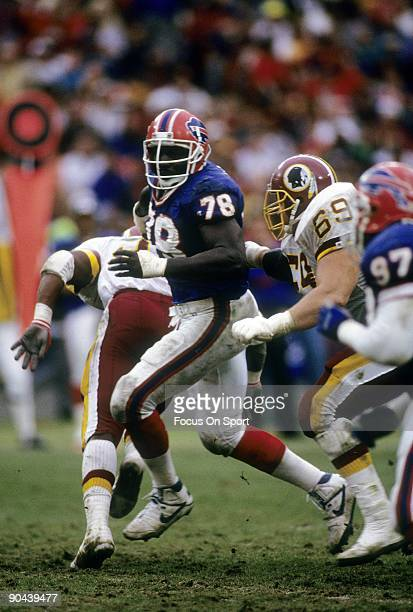 Bruce Smith of the Buffalo Bills in action gets past Mark Schlereth of the Washington Redskins December 30 1990 during a NFL football game at RFK...
