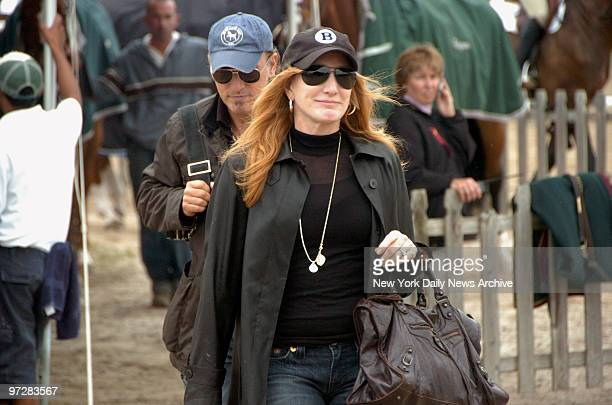 Bruce Springsteen and his wife Patti Scialfa arrive to watch their daughter Jessica compete in the 31st Annual Hampton Classic Horse Show in...