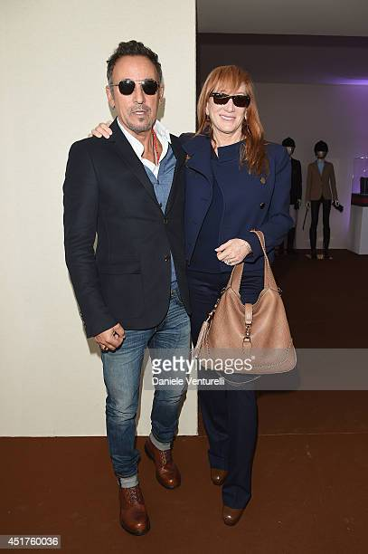 Bruce Springsteen and his wife Patti Scialfa attend the Paris Eiffel Jumping presented by Gucci at ChampdeMars on July 6 2014 in Paris France