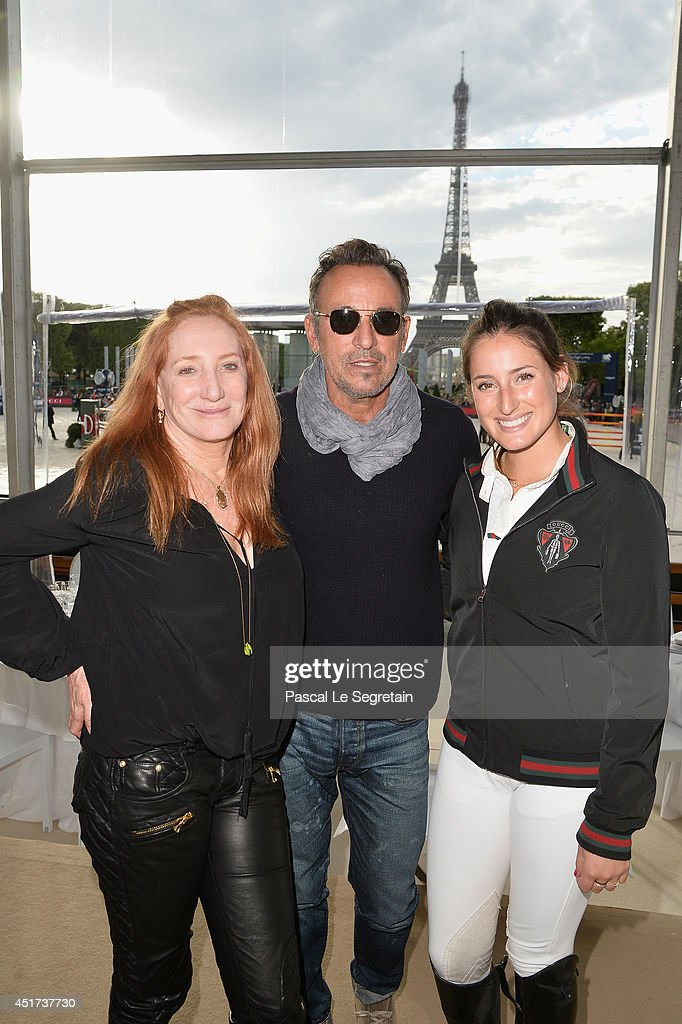 Bruce Springsteen (C) and his wife Patti Scialfa (L) pose with their daughter Jessica Springsteen (R) during the Paris Eiffel Jumping presented by Gucci at Champ-de-Mars on July 5, 2014 in Paris, France.