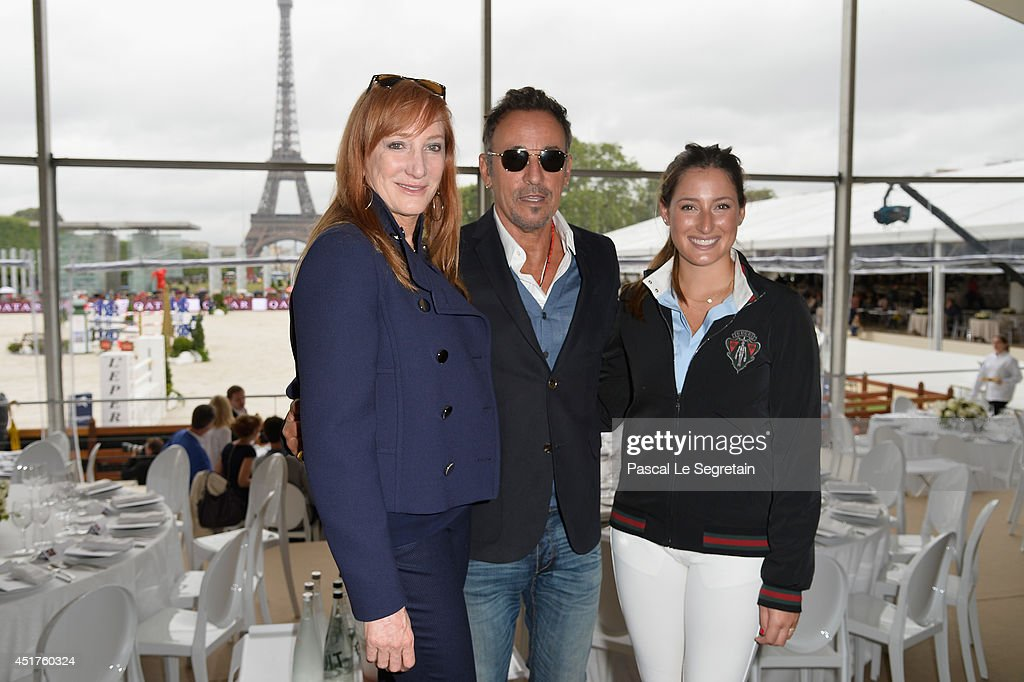 Bruce Springsteen (C) and his wife Patti Scialfa (L) pose with their daughter Jessica Springsteen (R) during the Paris Eiffel Jumping presented by Gucci at Champ-de-Mars on July 6, 2014 in Paris, France.