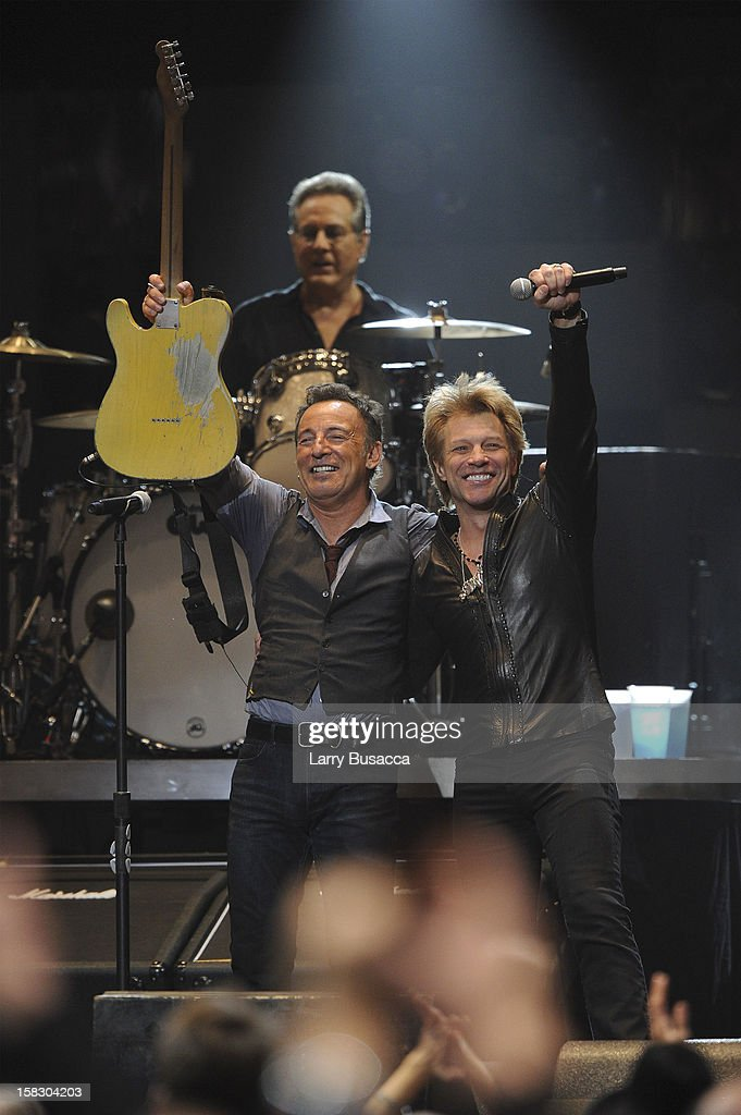 Bruce Springsteen and Jon Bon Jovi perform during '12-12-12' a concert benefiting The Robin Hood Relief Fund to aid the victims of Hurricane Sandy presented by Clear Channel Media & Entertainment, The Madison Square Garden Company and The Weinstein Company>> at Madison Square Garden on December 12, 2012 in New York City.