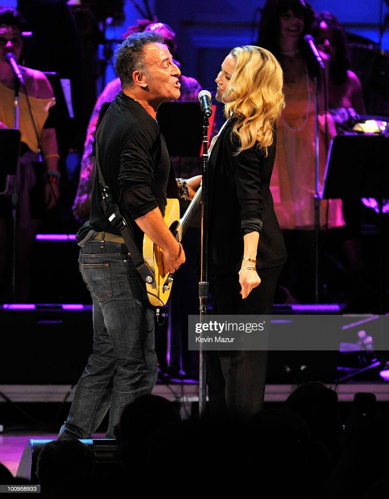 Bruce Springsteen and Kate Hudson perform on stage during the Almay concert to celebrate the Rainforest Fund's 21st birthday at Carnegie Hall on May 13, 2010 in New York City.