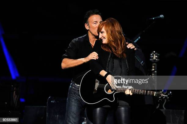 Bruce Springsteen and Patti Scialfa of Bruce Springsteen and the E Street Band perform onstage at the 25th Anniversary Rock Roll Hall of Fame Concert...