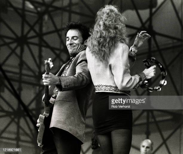 Bruce Springsteen and Patti Scialfa perform on stage with the E Street Band at Feyenoord Stadium De Kuip Rotterdam Netherlands 28th June 1988