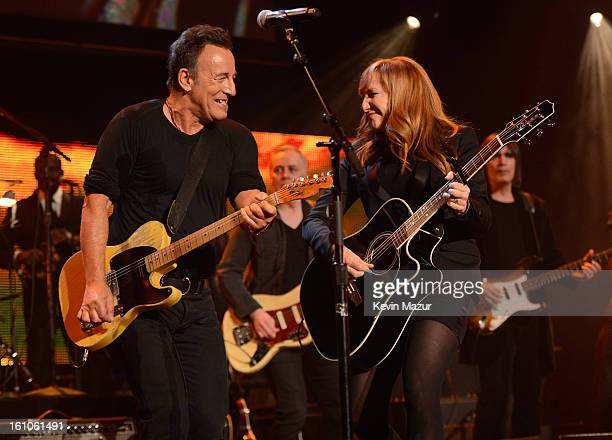 Bruce Springsteen and Patti Scialfa perform onstage at MusiCares Person Of The Year Honoring Bruce Springsteen at Los Angeles Convention Center on...