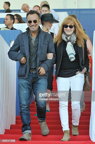 Bruce Springsteen and Patty Scialfa smile during the Dublin Horse Show 2014 on August 6 2014 in Dublin Ireland