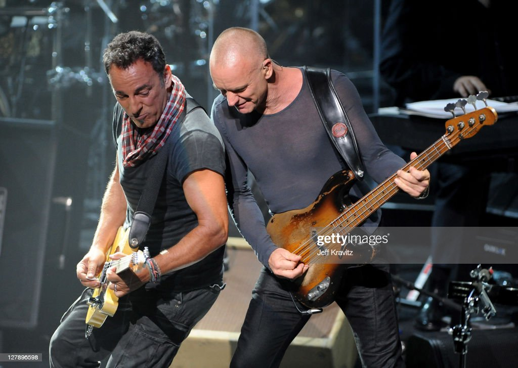 Bruce Springsteen and Sting perform on stage during