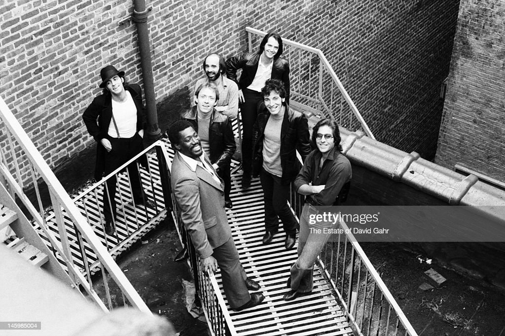 Bruce Springsteen and the E Street Band (Clockwise, top right: Garry Tallent, Bruce Springsteen, Maz Weinberg, Clarence Clemons, Danny Federici, Roy Bittan, Steve Van Zandt) pose for a portrait on October 17, 1979 in Red Bank, New Jersey.