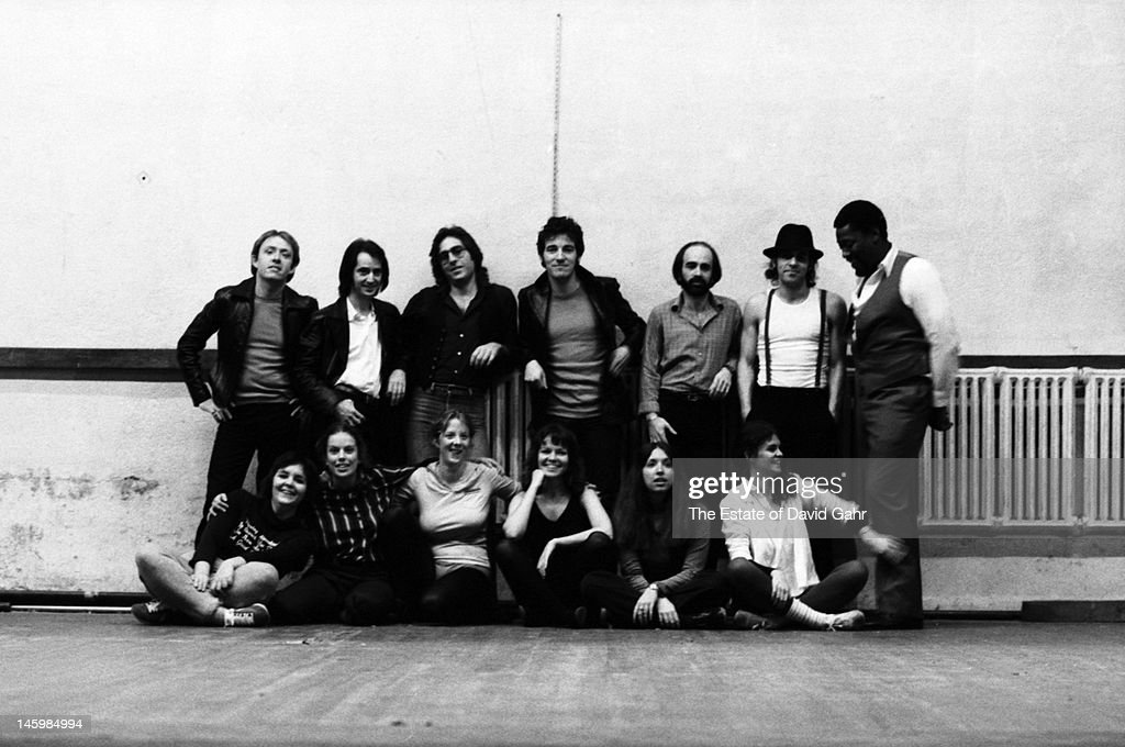 Bruce Springsteen and the E Street Band (L - R Danny Federici, Garry Tallent, Max Weinberg, Bruce Springsteen, Roy Bittan, Steve Van Zandt, Clarence Clemons) pose for a portrait with fans of the group on October 17, 1979 in Red Bank, New Jersey.