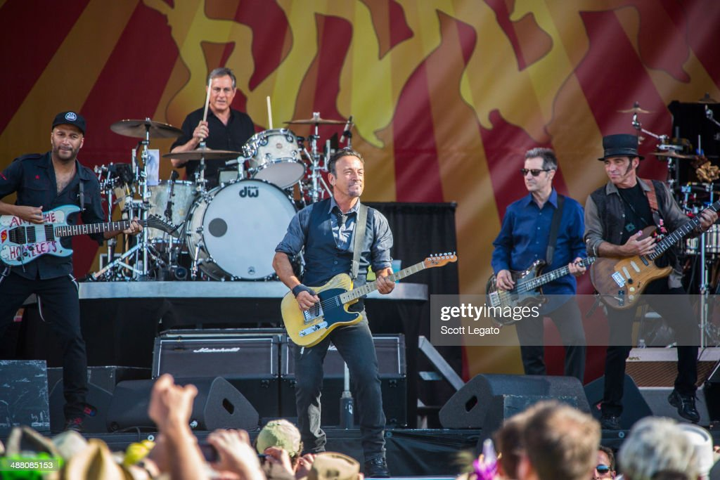 Bruce Springsteen and the E Street band with Tom Morello perform during the 2014 New Orleans Jazz & Heritage Festival at Fair Grounds Race Course on May 3, 2014 in New Orleans, Louisiana.