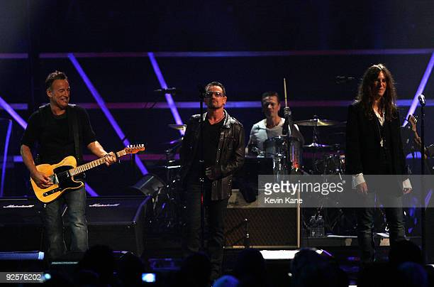 Bruce Springsteen Bono Larry Mullen Jr and Patti Smith perform onstage at the 25th Anniversary Rock Roll Hall of Fame Concert at Madison Square...
